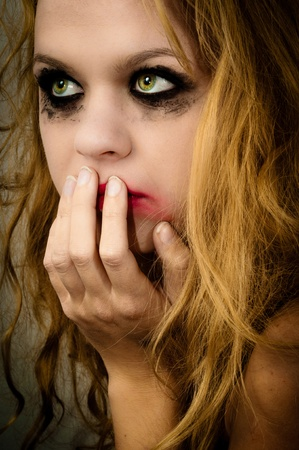 A depressed girl looks scared and waits for the rescue Stock Photo - 11508592