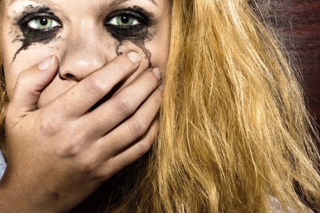 Blond girl covering her mouth Stock Photo - 11508603