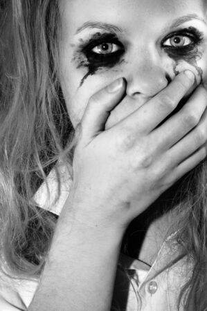 A depressed young girl covering her mouth Stock Photo - 11508593
