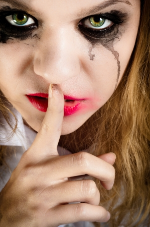A scary looking young woman showing silence Stock Photo - 11508533