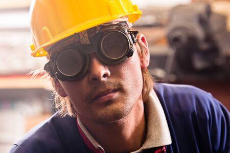Closeup of an industrial worker in yellow helmet photo