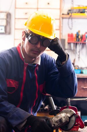 Industrial worker and his tools Stock Photo - 11507788