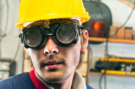Closeup of an industrial worker in yellow helmet photo