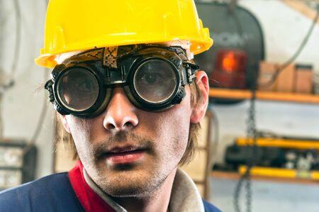 Closeup of an industrial worker in yellow helmet Stock Photo - 11508519
