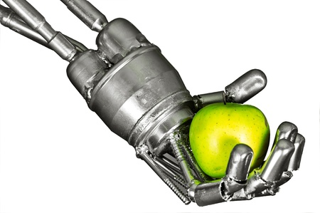 Robot hand with green apple on isolated white background photo