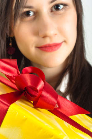Christmas present with a beautiful girl in the background Stock Photo - 11508084