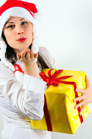 Girl giving a big kiss and a present Stock Photo - 11507954