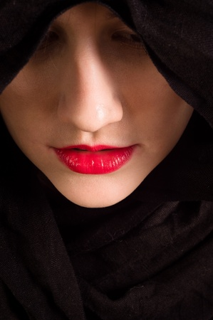 arab girl: Girl looking down with black hood