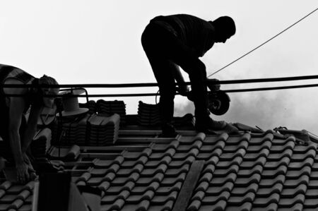 Industrial workers in hard work on the roof photo