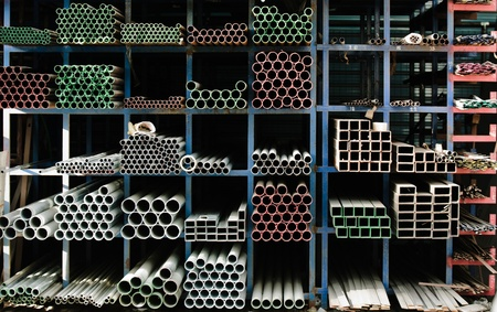 Pipes stacked up in a factory photo