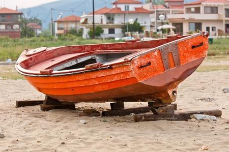 fishing scene: Abandoned fishing boat on the shore
