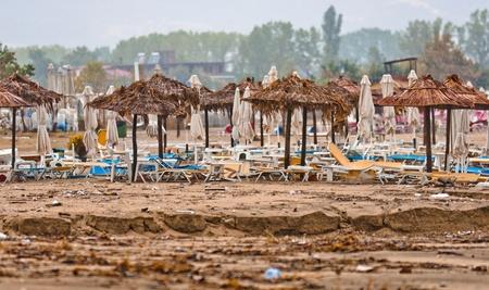 trashy: A dirty polluted beach  in the rain Editorial
