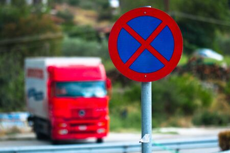 Traffic sign with car in the background photo