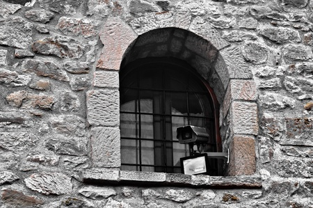 Modern Camera on old building photo