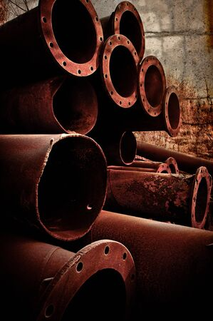 Stack of Rusty pipes  piled up Stock Photo - 12746272
