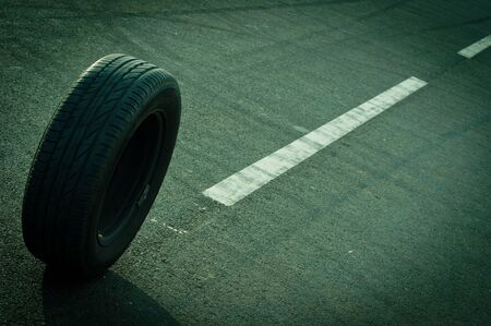 Car tire on the road photo