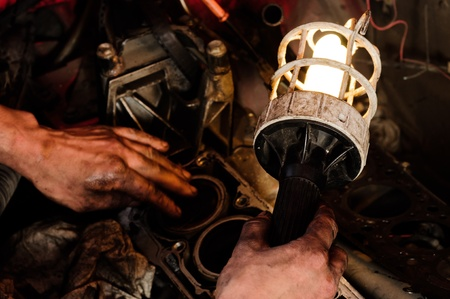 Mechanic worker inspecting car inters Stock Photo - 12745275