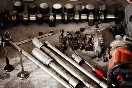 capping: Camshaft of a car with other tools Stock Photo