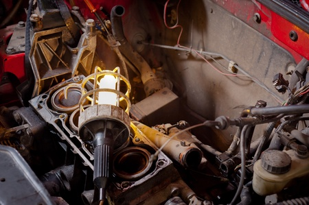 Industrial lamp on old motor block in a car Stock Photo - 12745605