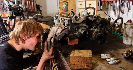 Worker Repairing car motor Stock Photo - 12717110