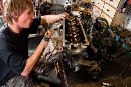 Mechanic worker inspecting car interiors Stock Photo - 12717111