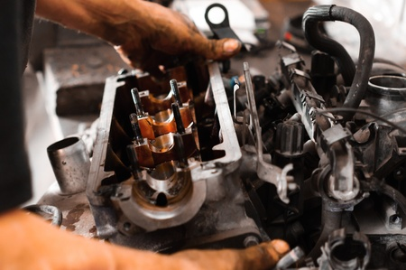 Used motor block with the hands of a worker Stock Photo - 12723310