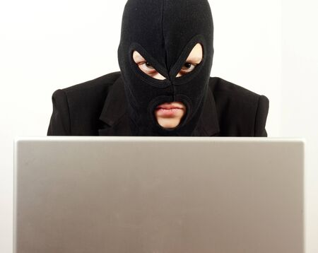 Woman internet hacker using laptop to rule the world photo