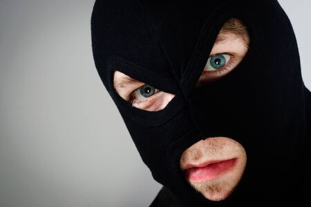 Man with the mask of the thief Stock Photo - 12723281