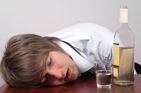 Young business man with alcohol Stock Photo