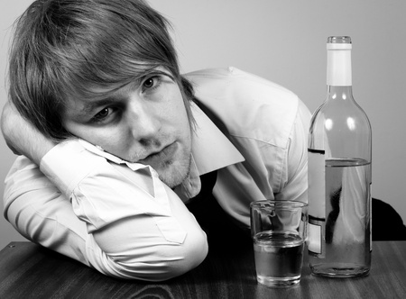 Business man with alcohol on table photo