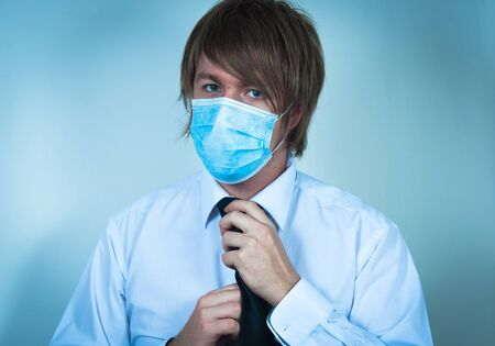 Man in protective mask in blue colors photo