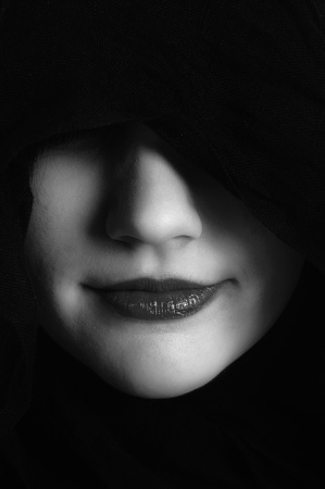 Woman in black hood in black and white
