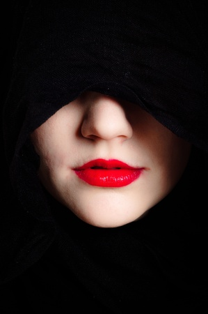 Closeup photo of a woman in black hood and red lips Stock Photo - 12723283