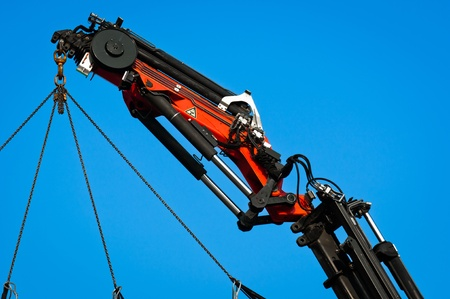 wire rope: Pneumatic industrial crane against blue sky