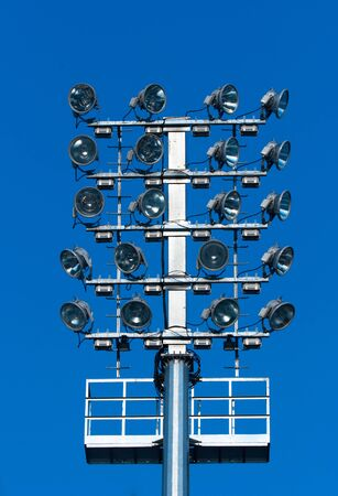 reflectors: Stadium lighting with a lot of reflectors against blue sky Stock Photo