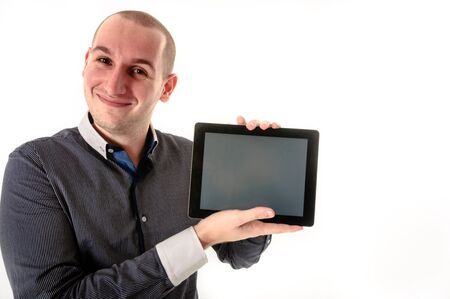 Handsome man with tablet against white background Stock Photo - 12986901
