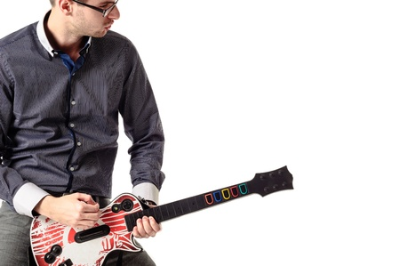 Young guitar artist against white background photo