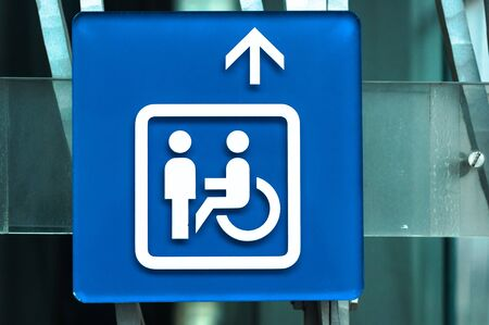 Handicap sign in blue closeup