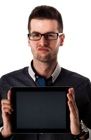 Handsome man with tablet against white background photo