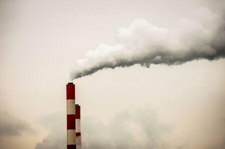Big chimney with smoke polluting the world photo