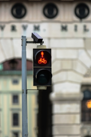 Pedestrian lamp in the city with blurry background photo