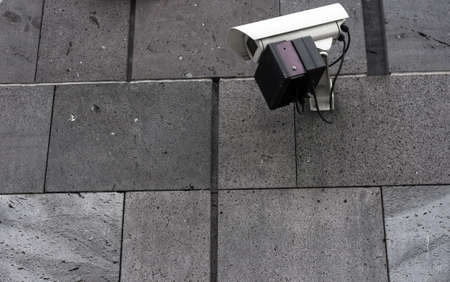 Security Camera on building wall photo