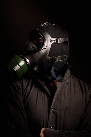 Handsome man in gasmask Stock Photo - 13610732