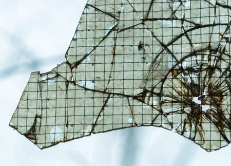 Broken window closeup with wires photo