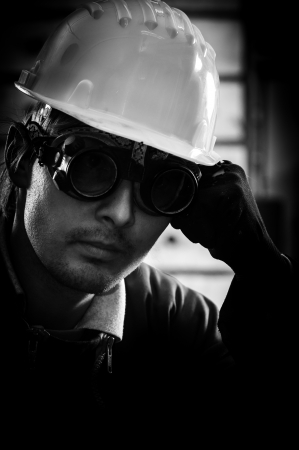 Hard working man in helmet Stock Photo - 13610623