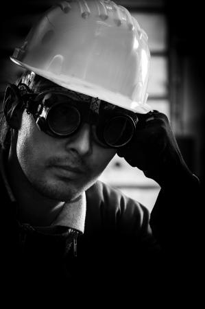 Hard working man in helmet Stock Photo - 13610623