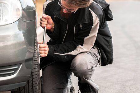 Young man repairing car ourdoors Stock Photo - 13610812