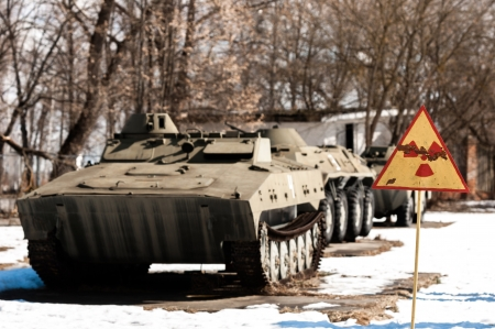 War machines with radioactivity sign at Chernobyl in the winter photo