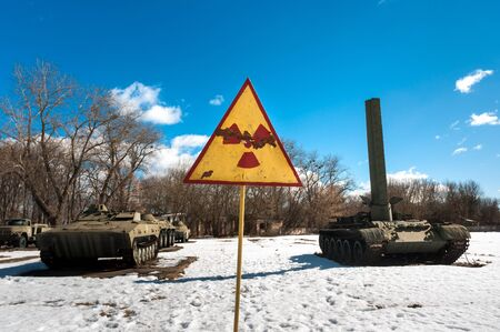 War machines with radioactivity sign at Chernobyl in the winter Stock Photo - 13611251