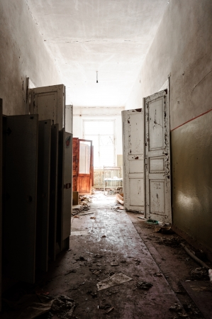 Doorway with bright light in an abandoned building photo
